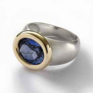 Sterling Silver and Yellow Gold Ring With Blue Oval Sapphire - Baltinester Jewelry